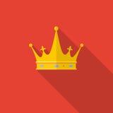在红色背景的金黄冠与长的阴影 免版税库存照片