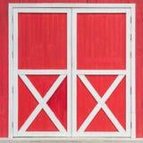 在红色背景的门 库存照片