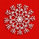 在红色背景的雪花 免版税库存照片