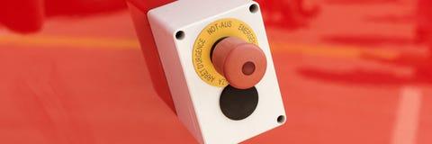 在红色背景的紧急按钮 库存照片