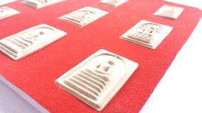 在红色背景的9菩萨泰国护身符集合收藏 库存图片