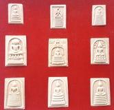 在红色背景的9菩萨泰国护身符集合收藏 免版税库存图片