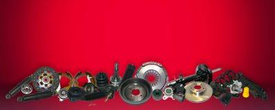 在红色背景集合的备件汽车 库存照片