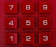 在红色计算器的数字 免版税库存照片