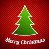 在红色镶边背景的绿色圣诞树 免版税库存照片