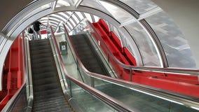 在红色隧道的自动扶梯 免版税库存照片