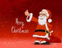 在红色backgroun的快乐的圣诞老人运载的袋子 免版税库存照片
