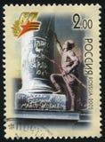 在纪念碑写着词在柏林的战士 库存照片