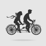 在纵排自行车的传染媒介夫妇 库存照片
