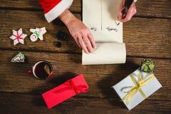 在纸卷的圣诞老人文字 免版税图库摄影