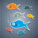 在纸板背景设置的抽象鱼 免版税图库摄影