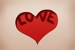 在纸的心脏保险开关与词 免版税图库摄影