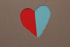 在纸的被撕毁的心脏 图库摄影