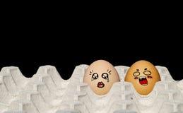 在纸盒的被绘的鸡蛋 免版税库存照片