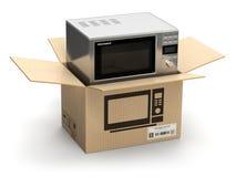 在纸盒纸板箱的微波炉 电子商务,互联网onl 免版税库存图片