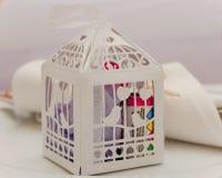 在纸笼子的婚礼厚待 库存图片