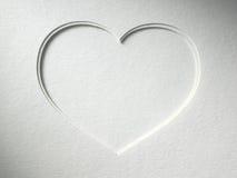 在纸背景的心脏 免版税库存照片