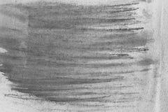 在纸背景纹理的黑水彩蜡笔 免版税库存图片