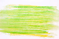 在纸背景纹理的绿色水彩蜡笔 库存照片