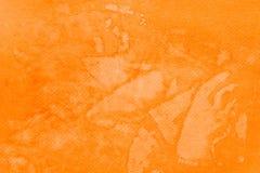 在纸背景纹理绘的橙色水彩 免版税图库摄影