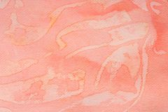 在纸背景纹理绘的红色水彩 免版税库存照片