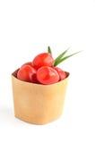 在纸袋的蕃茄在空白背景 库存图片