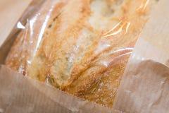 在纸袋的面包 库存照片