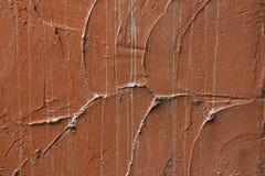 在纹理的橙色水泥墙壁 免版税库存图片