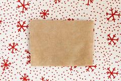 在纺织品背景圣诞节的空白的羊皮纸 免版税库存照片