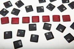 在组成的键盘的七个空白的红色按钮 库存图片