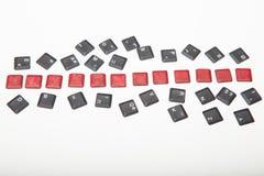 在组成的键盘的十二个空白的红色按钮 库存图片