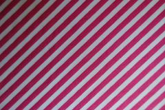 在织品的对角桃红色条纹 免版税库存图片