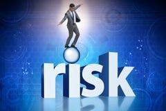 在经营风险和不确定性概念的年轻商人 免版税库存照片