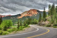 在绕山路的摩托车 图库摄影