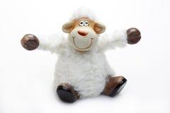 在绵羊微笑的玩具白色的背景 库存图片