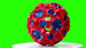 在绿色屏幕上的五颜六色的origami球 股票录像