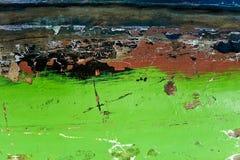 在绿色绘的木表面,剥油漆,概略的纹理背景,老木板,片段老 库存图片
