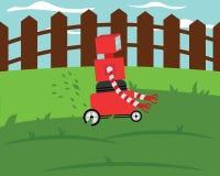 在绿色草坪的国内机器人grassmower切口草 图库摄影