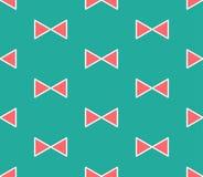 在绿色薄荷的背景的逗人喜爱的红色丝带 也corel凹道例证向量 免版税库存照片