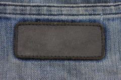 在缝合的标签蓝色牛仔裤 库存图片