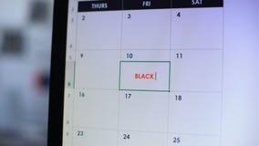 在网上日历预定的黑星期五,计划大购物,销售的人 股票录像