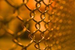 在网球场的铁丝网 库存图片