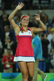 在网球妇女` s选拔里约2016年奥运会的决赛后,波多黎各的奥林匹克冠军莫妮卡德普伊赫庆祝胜利 库存图片