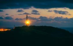 在罗卡角的灯塔在日落的葡萄牙 免版税库存照片