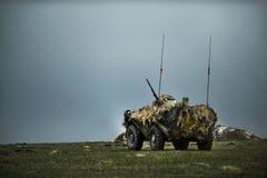在罗马尼亚军事多角形的罗马尼亚装甲车 免版税库存图片