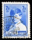 在罗马尼亚打印的邮票显示迈克尔国王画象  库存照片