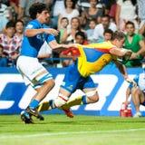 在罗马尼亚期间的橄榄球球员与涌现的意大利 库存照片
