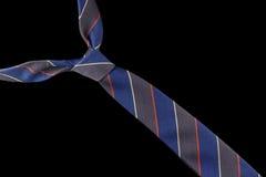 在羊毛的领带与红色,黄色和蓝色条纹 免版税库存照片