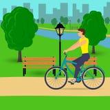 在美丽的城市公园供以人员骑一辆自行车 传染媒介平的例证 免版税库存照片