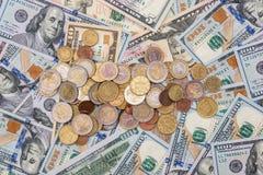 在美元的欧洲硬币 免版税库存照片